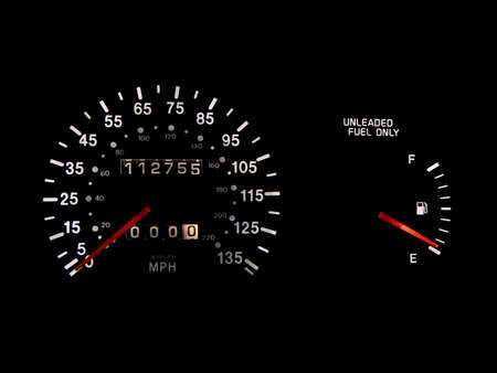 gas gauge: Speedometer and gas gauge with low gas isolated on black Stock Photo