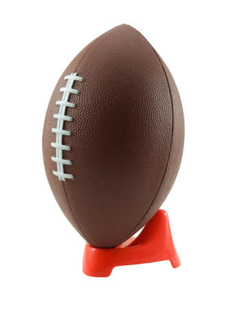 pigskin: Football on a kickers tee, isolated on white Stock Photo
