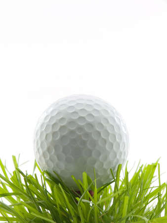 Golf ball on tee in grass, isolated on white Stock Photo