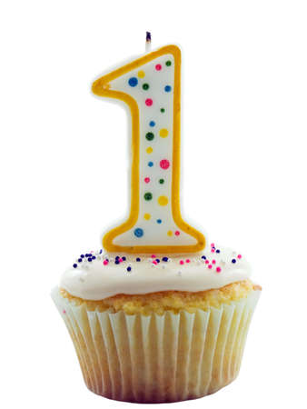 Cupcake with a number one candle on it for birthday, anniversary or other