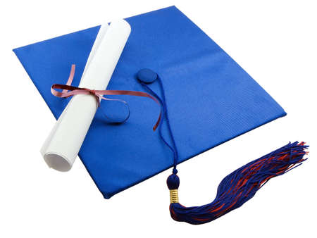 Diploma set on a graduation cap, isolated on white