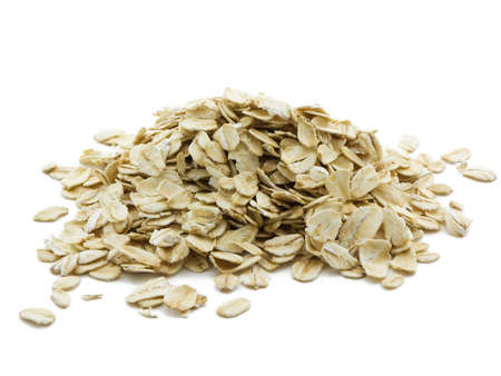 Pile of oats isolated on a white background