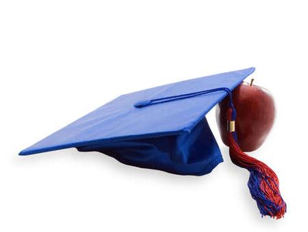 卒業の帽子と白で隔離アップル 写真素材