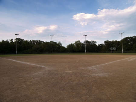 bases: Baseball field with a cloudy sky