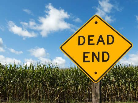 end road: Corn field with a dead end road sign in front of it Stock Photo