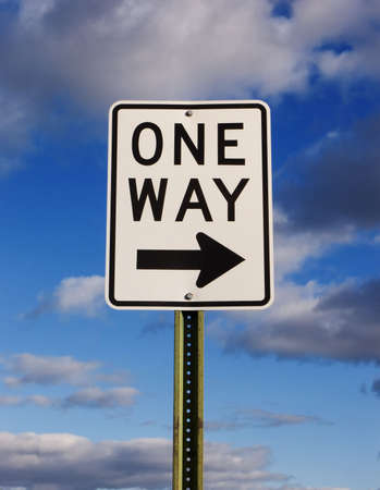 posting: One way sign with a cloudy blue sky background