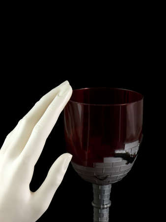 hand rubbing: Vampire goblet with hand rubbing the rim, isolated on black
