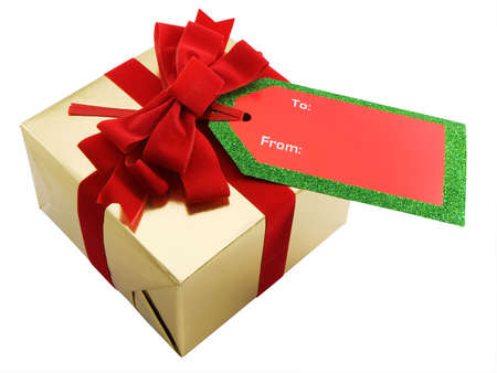Christmas present with a red bow and gift tag, isolated on white Stock Photo