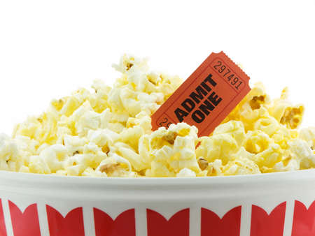 Bucket of popcorn with a admit one movie ticket, isolated on white