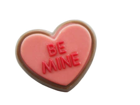 Be mine on a small candy heart isolated on white Banco de Imagens