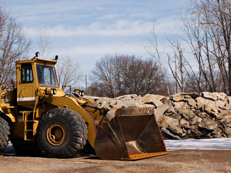 Front loader near a pile of large stones Stock Photo