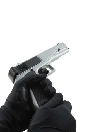 stickup: Gloved hands reloading a handgun, isolated on white