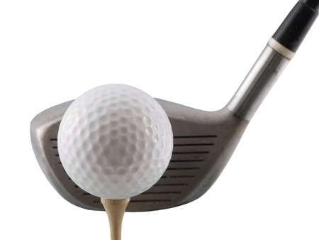 Golf ball on tee with club behind it, isolated on white