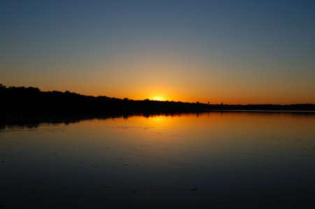 Sun rise over a still lake