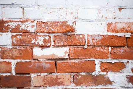 partially: Partially painted brick wall