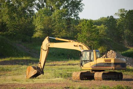 excavate: Excavator on a work site in rural America