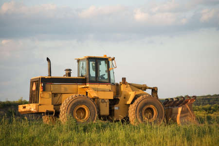 frontend: Front-end loader on a work site in rural America