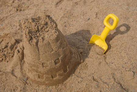 Sand castle and shovel in the sand
