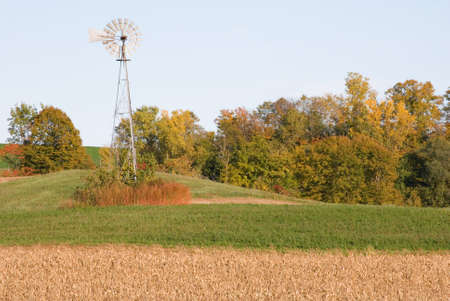 Windmill atop a field in the autumn months