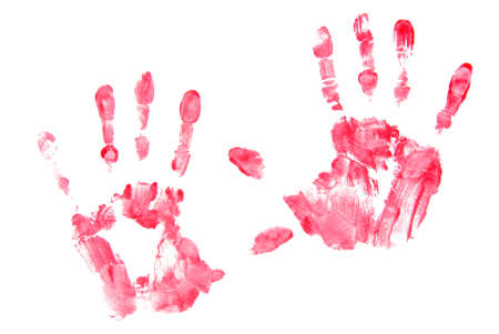 Left and right hand prints made with red paint on white background