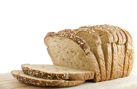 Sliced loaf of whole wheat bread isolated on white