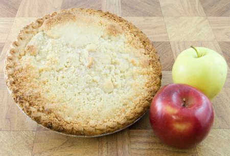 dutch: Dutch apple pie with a red and green apple set next to it