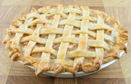 Baked apple lattice pie on a wooden table Stock Photo