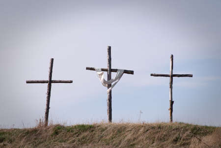 Three crosses on hilltop symbolizing the crucifixion