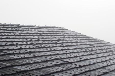 Shake shingles on roof with fog