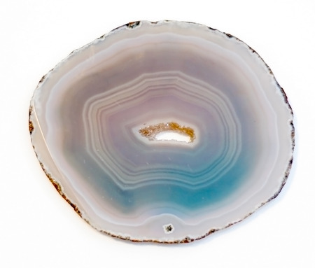 Vibrant and shiny agate rock slice isolated on white background 스톡 콘텐츠