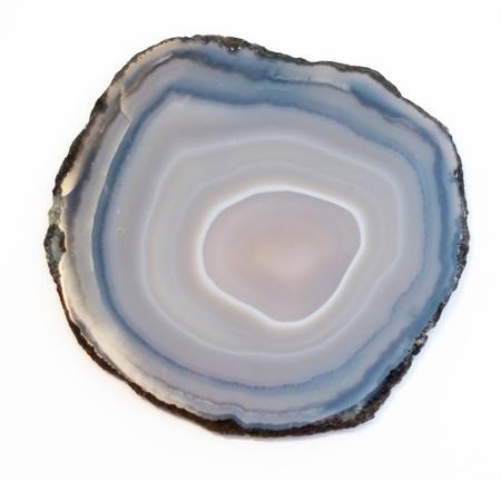 Vibrant and shiny agate rock slice isolated on white background Archivio Fotografico