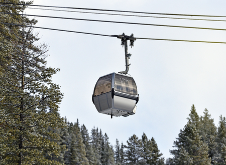 Gondola at ski resort among trees in winter