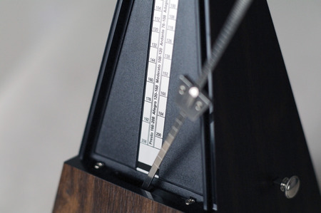 Metronome closeup in action isolated and on a plain background