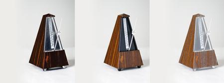 Metronome collage closeup on plain background