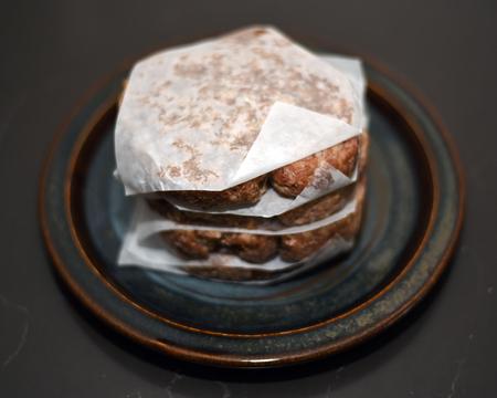Raw burger patties on plate