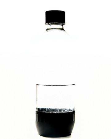 Clear plastic water bottle with black cap closeup