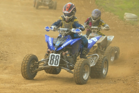 JEVICKO, CZECH REPUBLIC - JULY 23: Unidentified racers rides a quad motorbike in the Crossracing Cup 2011 on July 23, 2011 in the town of Jevicko, Czech Republic.