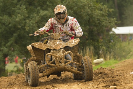 BELA U JEVICKA, CZECH REPUBLIC - JULY 23: Unidentified racer rides a quad motorbike in the Cross racing Cup 2011 on July 23, 2011 near the town of Jevicko, Czech Republic.