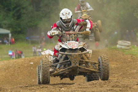 BELA U JEVICKA, CZECH REPUBLIC - JULY 23  Unidentified young racer rides a quad motorbike in the  Cross racing Cup 2011  on July 23, 2011 near the town of Jevicko, Czech Republic   Stock Photo - 12790268