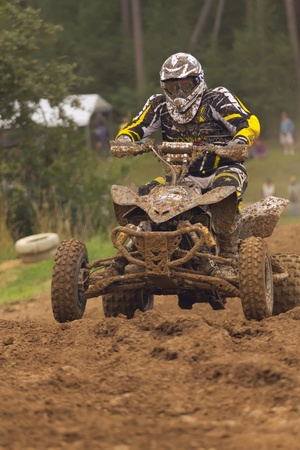 BELA U JEVICKA, CZECH REPUBLIC - JULY 23  Unidentified racer rides a quad motorbike in the  Cross racing Cup 2011  on July 23, 2011 near the town of Jevicko, Czech Republic   Stock Photo - 12790250