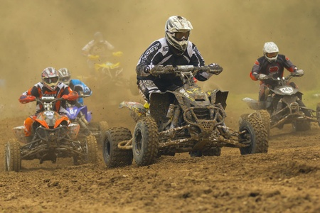 JEVICKO, CZECH REPUBLIC - JULY 23  Unidentified racers rides a quad motorbike in the  Crossracing Cup 2011  on July 23, 2011 in the town of Jevicko, Czech Republic   Stock Photo - 12790244