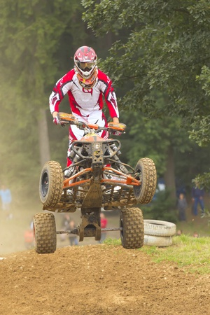 BELA U JEVICKA, CZECH REPUBLIC - JULY 23  Unidentified racer rides a quad motorbike in the  Cross racing Cup 2011  on July 23, 2011 near the town of Jevicko, Czech Republic   Stock Photo - 12790260