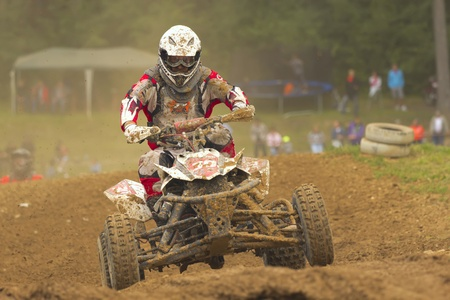 BELA U JEVICKA, CZECH REPUBLIC - JULY 23  Unidentified racer rides a quad motorbike in the  Cross racing Cup 2011  on July 23, 2011 near the town of Jevicko, Czech Republic   Stock Photo - 12790240