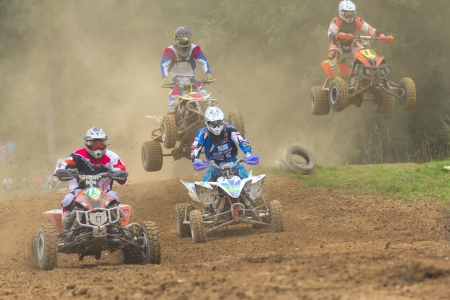 JEVICKO, CZECH REPUBLIC - JULY 23  Unidentified racers rides a quad motorbike in the  Crossracing Cup 2011  on July 23, 2011 in the town of Jevicko, Czech Republic   Stock Photo - 12790261