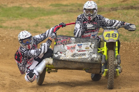 JEVICKO, CZECH REPUBLIC - JULY 23  Unidentified racers rides a sidecar in the  Sidecarcross Cup 2011  on July 23, 2011 in the town of Jevicko, Czech Republic