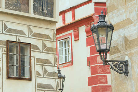 Colorful historic houses of the city, which is called Cesky Krumlov and the old lamps on the wall  Czech Republic, Europe