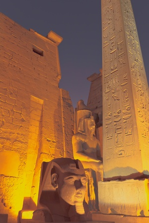 The obelisk and statue of the King Ramses II  at the entrance to Luxor Temple  Egypt   photo