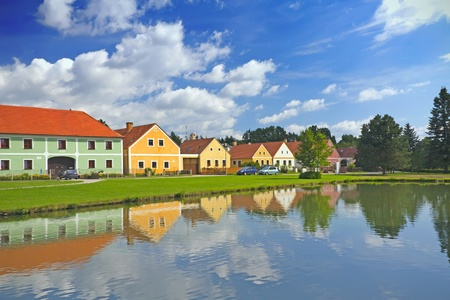 Rural decorated houses in Zabori   Czech Republic  in South Bohemia  In the foreground is the village pond