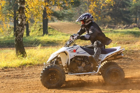 """ZABREH, CZECH REPUBLIC - OCTOBER 30. Unidentified racer rides a quad motorbike in the """"Zabrezky Motocross"""" on October 30, 2010 in the town of Zabreh, Czech Republic."""