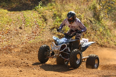 ZABREH, CZECH REPUBLIC - OCTOBER 30. Unidentified racer rides a quad motorbike in the